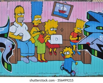 LONDON - NOVEMBER 22, 2015. The fictional Simpsons family as street art on fencing at Shoreditch in the Borough of Tower Hamlets, an area renown for its public painting and posters in east London, UK.