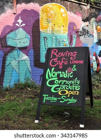 LONDON - NOVEMBER 22, 2015. Notice board and street art in the Nomadic Community Gardens at Shoreditch in the Borough of Tower Hamlets, an area renown for its public painting in east London.