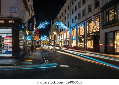LONDON - NOVEMBER 25, 2016: Christmas lights on New Bond Street. The already glamorous area has been given a glittering makeover for the Christmas season with sprays of peacock-inspired decorations.