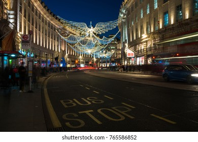 LONDON - NOVEMBER 25, 2017: Christmas lights on Regent Street, London, UK. The Christmas lights attract thousands of shoppers during the festive season and are a major tourist attraction in London