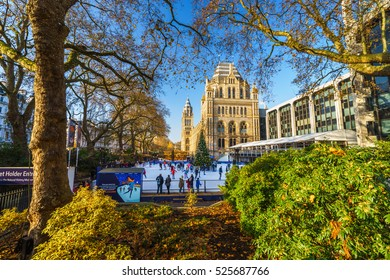 LONDON - NOVEMBER 27, 2016: Ice-skating people at the famous Natural History Museum's annual Swarovski Ice Rink