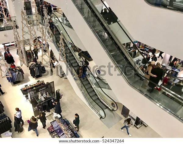 LONDON - NOVEMBER 27: Christmas Shoppers inside John Lewis Oxford Street Department Store during the Black Friday Weekend Sales on November 27, 2016 in London, UK.