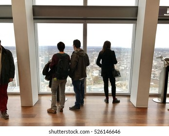 LONDON - NOVEMBER 27: People view the urban sprawl from the observation gallery on the 69th floor of The Shard on November 27, 2016 in London, UK.