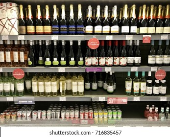 LONDON - NOVEMBER 29, 2016: Wine and alcoholic mixers in the refrigerator section at Waitrose John Barnes, Finchley Road, London.