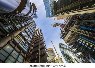 LONDON - NOVEMBER 3, 2016: The Lloyds Building and The Gherkin skyscrapers are joined by new construction in the city's insurance quarter.