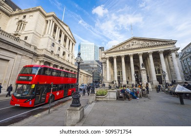 LONDON - NOVEMBER 3, 2016: Modern red double-decker bus passes in front of the Bank of England and Royal Exchange in the city's financial center.
