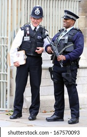 LONDON - Oct 12: Since the London terrorist bombings in July 2005, British police are prominently visible at popular tourist destinations, on Oct 12, 2013 in London, England
