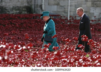 LONDON - OCT 16, 2014: Her Majesty The Queen and the Duke of Edinburgh visit the Tower of London to view the poppy display commemorating the centenary of the outbreak of World War I