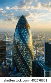 LONDON - OCTOBER 1: Gherkin building (30 St Mary Axe) during sunrise in London on October 1, 2015. 30 St Mary Axe building is one of architectural symbols of London, thanks to it's shape named Gherkin
