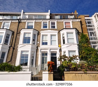 LONDON - OCTOBER 11, 2015. Fine large nineteenth century terraced houses now with roof extensions overlooking the River Thames in west London, UK.
