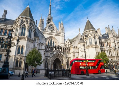 LONDON - OCTOBER 13, 2018: A modern Routemaster double-decker bus passes in front of the landmark Royal Courts of Justice on Fleet Street.