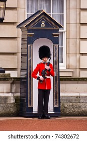 LONDON - OCTOBER 15: Sentry of the Grenadier Guards posted outside of Buckingham Palace on October 15, 2010 in London U.K..