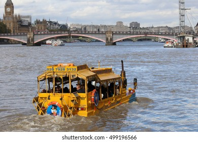 London, October 16 2016. On a cloudy, overcast day, a London Duck Tours amphibious vehicle gives a tour of London from the River Thames