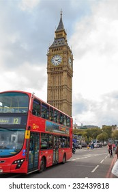 LONDON - OCTOBER 17: London Buses with Big Ben on October 17, 2014 in London. London Bus service is one of the largest urban bus networks in the world with 8,000 buses covering 700 routes.