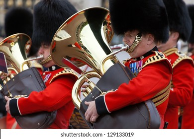 LONDON - OCTOBER 18: Marching the Queen's Guards during traditional Changing of the Guards ceremony at Buckingham Palace on October 18, 2012 in London, United Kingdom. Trumpeters of the Royal Guard