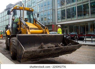 LONDON - OCTOBER 18TH: Unidentified workman operates a JCB on October 18th, 2014 in London, England, UK. JCB is one of the world's top manufacturers of construction equipment.