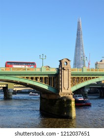 LONDON - OCTOBER 20, 2018. A section of Southwark Bridge, over the River Thames with the Shard skyscraper beyond in London, England, UK.