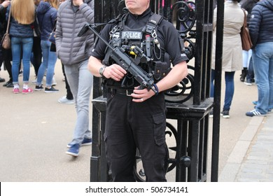 London, October 2016. An armed London Metropolitan police officer equipped with Taser and automatic rifle patrols in Whitehall, the traditional home of the United Kingdom Government