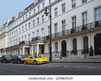 LONDON - OCTOBER 2016:  The low rise apartment buildings of Belgravia are among the most exclusive in London, and the expensive cars parked outside are consistent with that.
