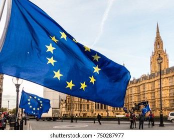 London, October 2017. A european union flag flying outside the Houses of parliament, in Parliament Square.