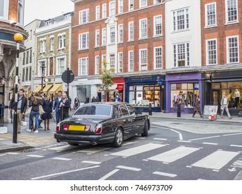 LONDON- OCTOBER, 2017: An expensive Bentley car driving through Marylebone Village on Marylebone High Street, London.