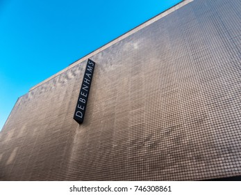 London, October 2017. A sign above the Debenhams department store on Oxford Street. It is set against 180,000 hanging brushed aluminium panels, designed by arcitect, Ned Kahn.