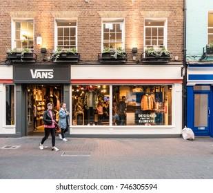 London, October 2017. Unidentified people walking outside the Vans store in Carnaby Street.