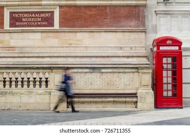 LONDON- OCTOBER, 2017: Victoria and Albert Museum. British red phone box and V&A 'Henry Cole Wing' sign outside the Victoria and Albert Museum, in Kensington, London.