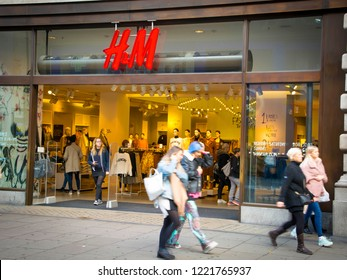 LONDON- OCTOBER, 2018: H&M store exterior on Oxford Street with shoppers walking by. A large British fashion store chain