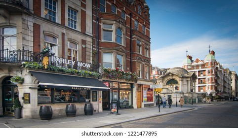 LONDON- OCTOBER, 2018: Mayfair shopping street scene, an upmarket and area of Westminster with many luxury stores and restaurants