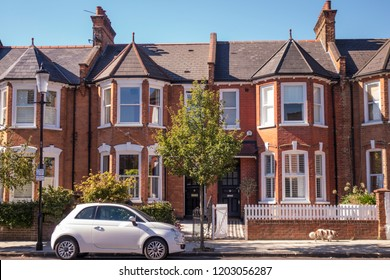 LONDON- OCTOBER, 2018: Typical residential red brick homes in West London with car parked outside
