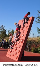 LONDON - OCTOBER 27. Children enjoying the climbing wall on October 27, 2014, in the park at Stratford in the Borough of Newham; an area currently experiencing regeneration in east London, UK.