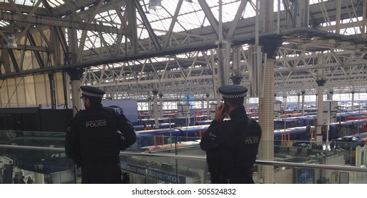 London, October 27th 2016, Armed British Transport police officers patrol at London's Waterloo railway station while openly carrying firearms