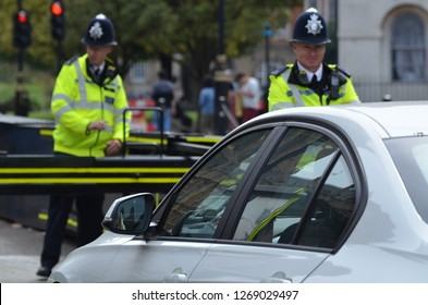 London - October 28 2018: Metropolitan police officers stand guard at barricades around the Palace of Westminster.