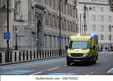 London, October 30th 2016. An ambulance operated by the London Ambulance Service races along Millbank with lights flashing as it responds to an incident