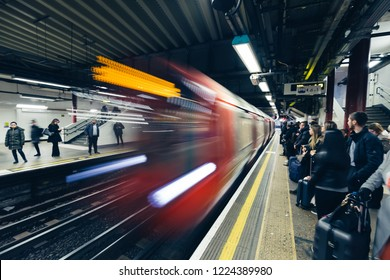 LONDON - OCTOBER 31, 2018: Train arriving at platform on London Underground tube station