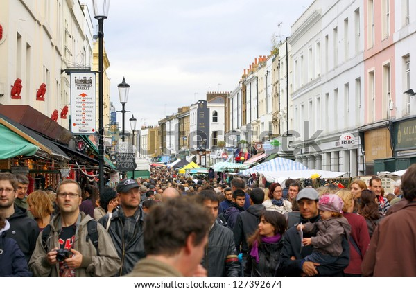 LONDON - OCTOBER 3RD : Visitors crowd the main thoroughfare of Portobello Road Market on 3rd October 2009, currently one ot the top twenty shopping destinations in London.