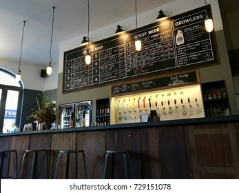 LONDON - OCTOBER 5, 2017: The bar at The Horseshoe Pub in Hampstead, London, UK. Camden Town Brewery was founded in the basement of the pub.