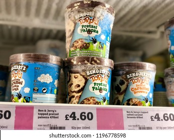 LONDON - OCTOBER 5, 2018: Ben & Jerry's Ice Cream tubs on sale in the frozen section of Sainsbury's supermarket in London, UK.