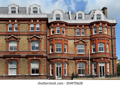 London, old fashioned apartment building with shops