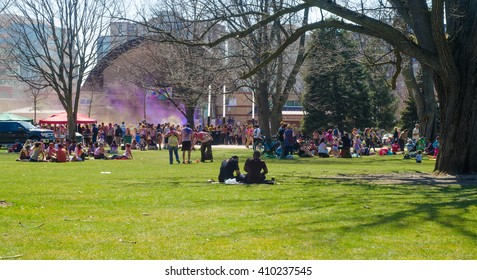 London Ontario, Canada - April 16: Unidentified young colorful people having fun and celebrating at the Festival of Colours on April 16.2016 in London Ontario, Canada as editorial