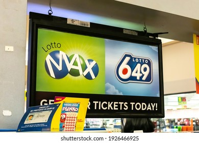 London, Ontario, Canada - February 26 2021: A lotto 649 ticket booth in Sherwood Forest Mall with a stack of Plinko cards in front.