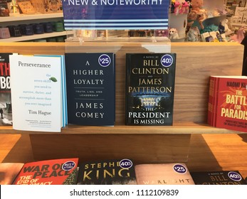 London Ontario Canada, June 13 2018: editorial photograph of bill Clinton's new book next to James comey book at a store. Both authors criticized Donald trump.