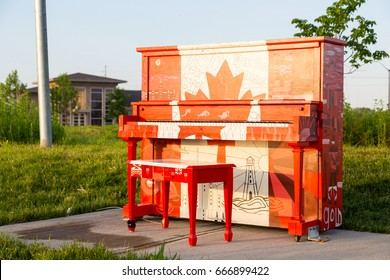London, Ontario, Canada-June 3 2017: The Hyde Park outdoor Piano painted by the students of Oakridge school in the theme of our Canadian 150 year celebration. The piano is left outside for the summer.