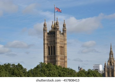 London Palace of Westminster Victoria Tower with Union Jack flag on top.
