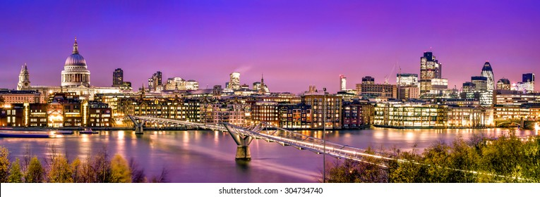 London Panorama:  St. Paul's Cathedral, Millennium Bridge and  the Financial District at twilight.