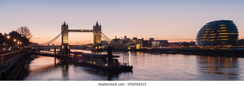 London - Panorama view along the river thames showing Tower Bridge and City Hall with Tower Millennium Pier in the foreground