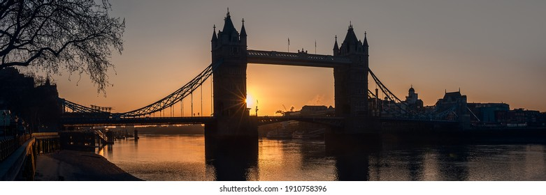 London - Panorama view of Tower Bridge silhouetted against dawn sun