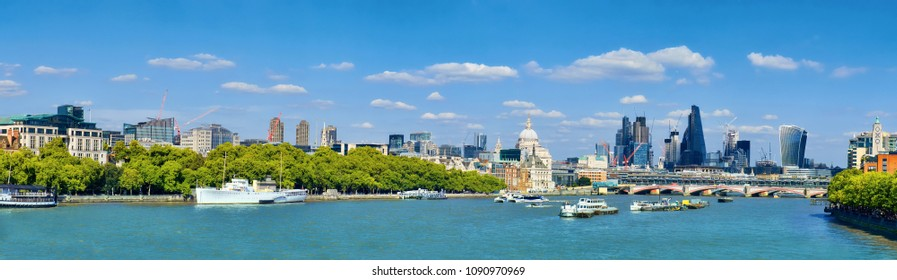 London, panoramic view over Thames river with London skyline on a bright day in Spring. This image is toned.