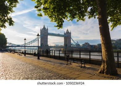 London - The  promenade and Tower bridge in morning light.